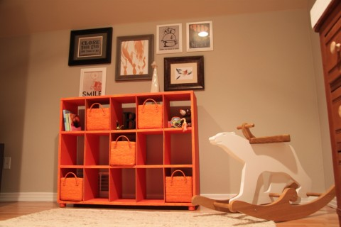 The orange bookcase was a $50 antique store find. Some orange paint and  baskets gave it a new life and added a modern personality. - Orange « Buymodernbaby.com