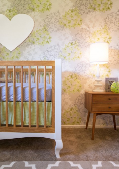 Crib and side table in modern lime green nursery from Little Crown Interiors